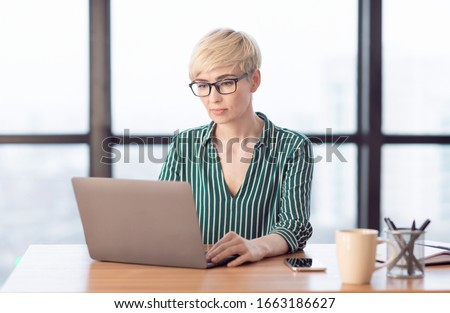 Female Entrepreneurship. Concentrated Businesswoman Using Laptop Sitting At Workplace In Modern Office. Selective Focus #1663186627