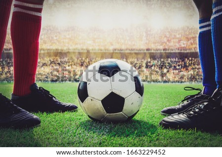 feet of soccer players kick off in the stadium match #1663229452