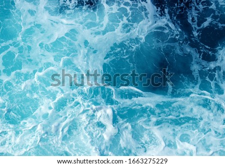 Abstract blue sea water with white wave for background #1663275229