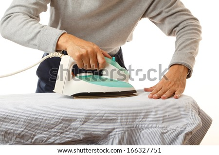Man doing housework, ironing his shirt.