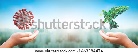 hope concept: praying and free bird and COVID-19 Corona virus on nature background Royalty-Free Stock Photo #1663384474