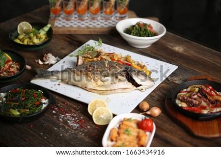 grilled sea bream steak with vegetables  #1663434916