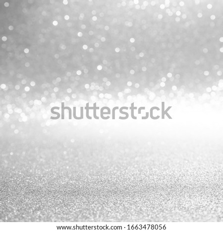silver and white bokeh lights defocused. abstract background #1663478056