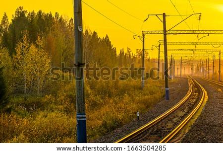 Sunrise railway track scene. Railway tracks sunrise in morning. Sunrise railway track view. Sunrise railroad track #1663504285
