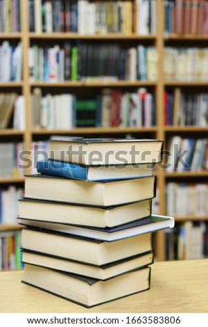 Stack of Books on the table in library #1663583806