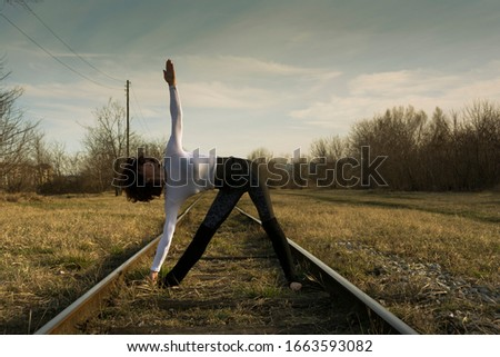 Portrait of  woman practicing yoga  on a abandoned railway in nature #1663593082