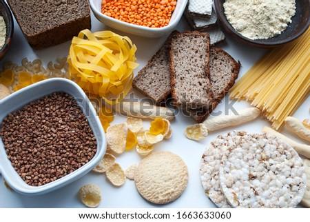 gluten free set. Gluten free food. Various gluten free pasta, bread, snacks and flour. Grains of corn. Royalty-Free Stock Photo #1663633060