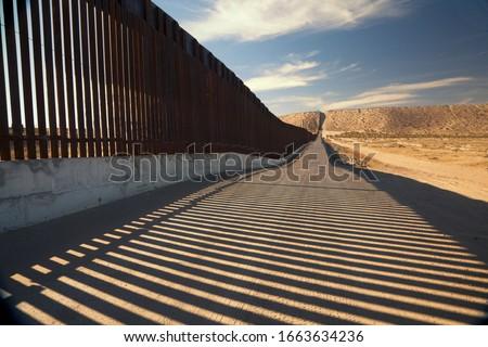 The border fence between Anapra, New Mexico and Juarez Mexico Royalty-Free Stock Photo #1663634236