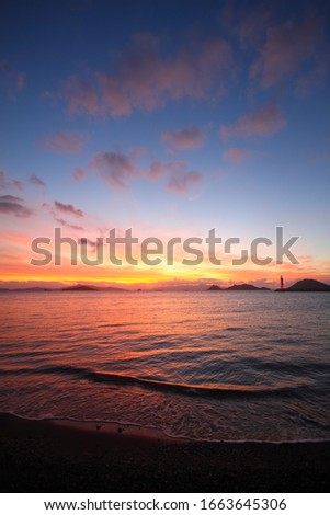 Dramatic red and orange sky and clouds abstract background. Red-orange clouds on sunset sky. Warm weather background. Art picture of sky at dusk