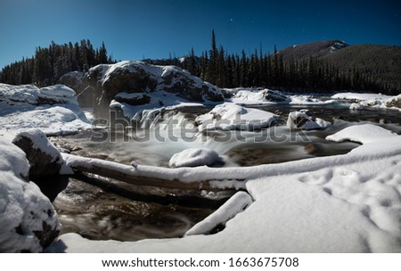 Elbow Falls Alberta at Night in Winter with Snow #1663675708