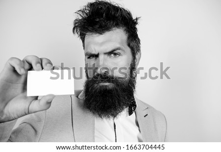 self presentation. serious bearded man business card. copy space. mature businessman. blank piece of paper. barbershop concept. best barber master. barber shop for gentlemen. brutal male beauty.