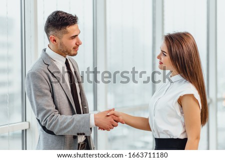 Two businesspeople talking in conference room, involved in the process of negotiation. #1663711180