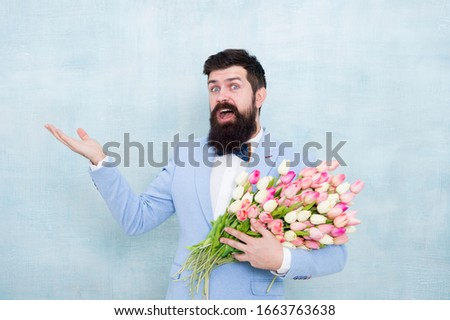 Flower bouquet for womens day. Bearded man with tulips. Flowers shop. Ideas to celebrate. Spring mood. Love date. Gift bouquet. Bearded man hipster with flower bouquet. Greetings concept. 8 march. #1663763638