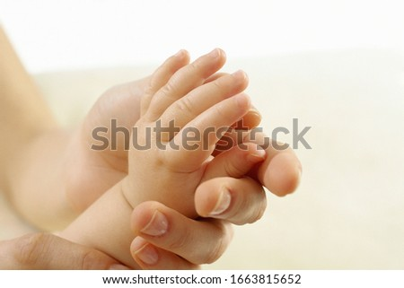 Baby hand in adult hand #1663815652