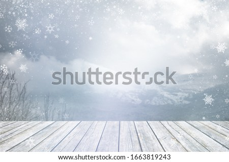 The snowy wooden desk on winter background with snowflakes #1663819243