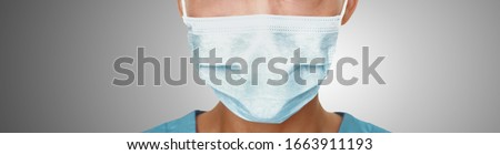 Coronavirus surgical mask doctor wearing face protective mask against corona virus banner panoramic medical professional preventive gear. #1663911193