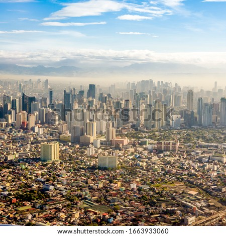 Metro Manila Skyline viewed from Airplane, as of 2020. visible in picture are Pasay, Makati, Eastwood city and mountains of Rizal. Shot in the morning, 7am