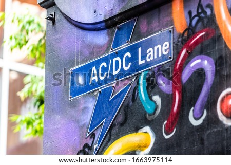 The street sign for AC/DC Lane in the city of Melbourne, Australia Royalty-Free Stock Photo #1663975114