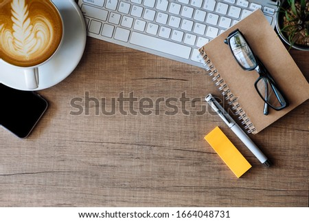 Office equipment placed on a wooden table. #1664048731