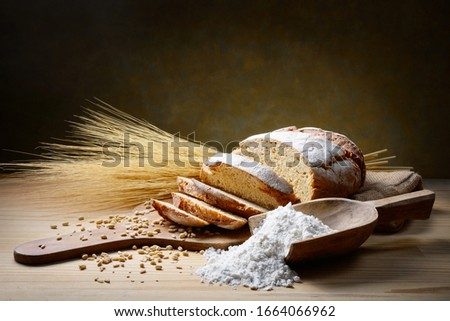 Traditional baked bread in rustic setting. #1664066962