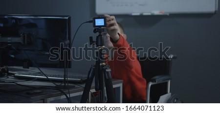 Medium shot of a boy in wheelchair recording a video for a vlog #1664071123