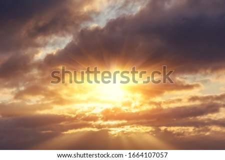 Divine glow through the clouds of the evening warm sun. Concept of peace and happiness. #1664107057