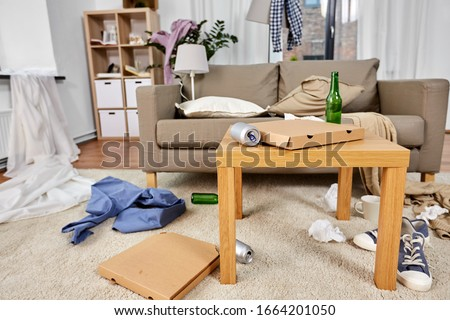 mess, disorder and interior concept - view of messy home living room with scattered stuff #1664201050