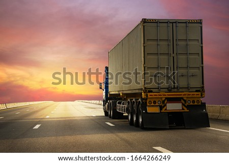 Cargo Truck driving on highway road with container, transportation concept.,import,export logistic industrial Transporting Land transport on the expressway againt sunrise sky #1664266249