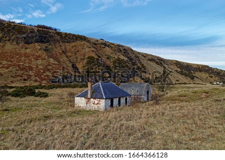 An abandoned Fishermen's Cottage and Ice house set back from the beach at St Cyrus, beneath the Volcanic Cliffs. #1664366128