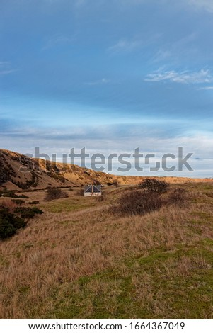 An abandoned Fishermen's Cottage and Ice house set back from the beach at St Cyrus, beneath the Volcanic Cliffs. #1664367049
