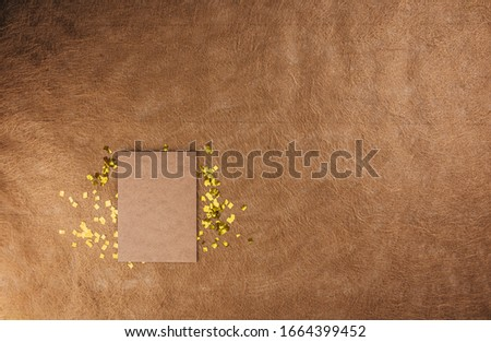 Black picture frame and glitter on the brown textured background