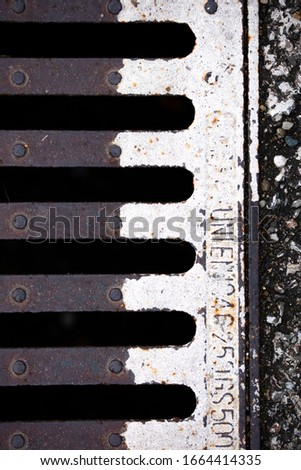 an original view of a manhole full of character, pattern, texture