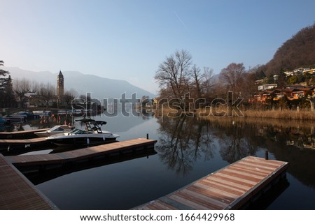 """a beautiful picure of the characteristic """"the strait"""" of Lavena Ponte Tresa, Lake of Lugano, Italy"""