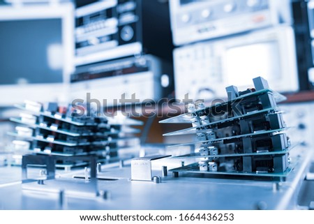 Microchips are stacked on top of each other on metal plates in the manufacture of super modern powerful computer equipment for a modern cardiology clinic. Powerful specialized computers concept #1664436253
