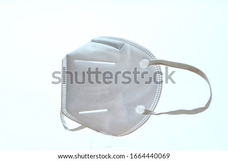 KN95 or N95 mask for protection pm 2.5 and corona virus (COVID-19).Anti pollution mask.air face mask.N95 mask with white background. Royalty-Free Stock Photo #1664440069