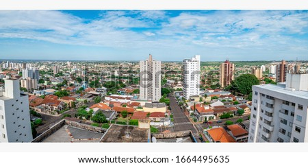 Panoramic aerial view of a low density city with few tall buildings. Photo taken at Campo Grande MS, Brazil, Avenida Amazonas avenue.