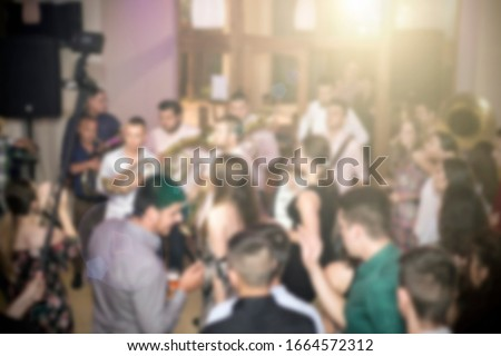 Birthday party, night out or New Year celebration with traditional Serbia trumpet orchestra. Blurred image for background use.