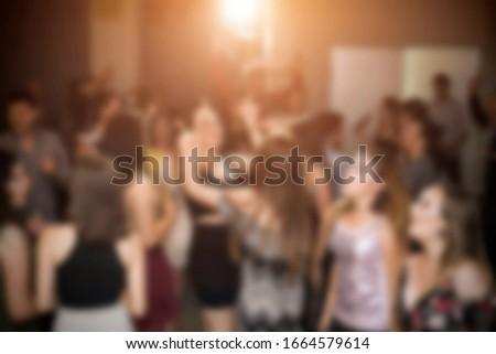 Night out, clubbing, birthday party or New Year celebration. Blurred image for background use.