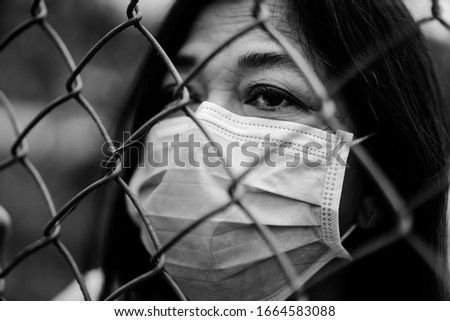 Covid-19 or Coronavirus concept.Senior old woman wearing mask for protect and quarantine virus Covid-19 virus outbreak in India.Indian old woman at home fence.Epidemic corona virus symptoms. #1664583088