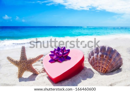 Starfish and seashell with heart  on the sandy beach by the ocean #166460600