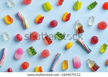Candy variety pattern on a blue background viewed from above. Top view Royalty-Free Stock Photo #1664670112
