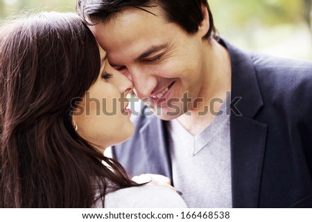 Adult couple having fun in the park #166468538
