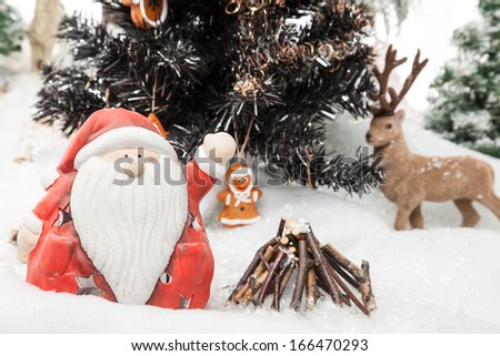 Santa Claus is waving to everybody and wishes merry Christmas.