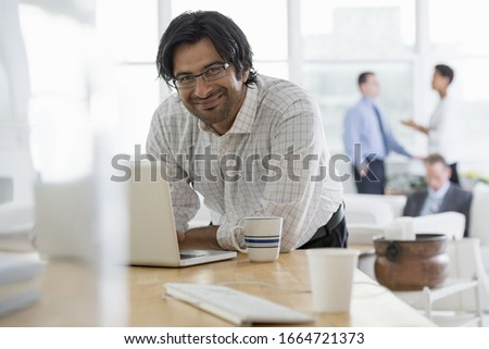 A group of people in the city. A business environment, an office workplace. A young man using a laptop computer on a desk. Royalty-Free Stock Photo #1664721373