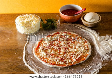 italian pizza uncooked on wooden table on night light #166473218
