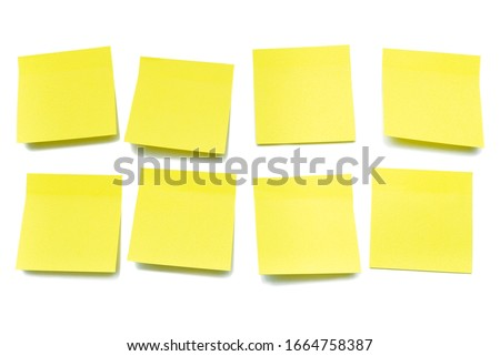 Yellow sheets for notes on a white background, isolate Royalty-Free Stock Photo #1664758387