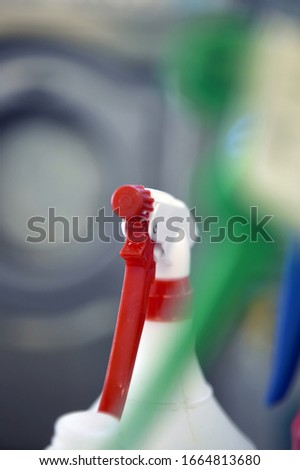 View of a squirt bottle against blurred background #1664813680