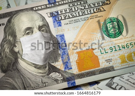 One Hundred Dollar Bill With Medical Face Mask on Benjamin Franklin. #1664816179