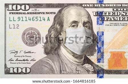 One Hundred Dollar Bill With Medical Face Mask on Benjamin Franklin. Royalty-Free Stock Photo #1664816185