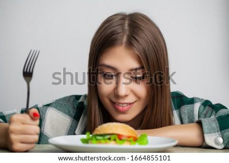 Nice girl wants to eat hamburger harmful #1664855101